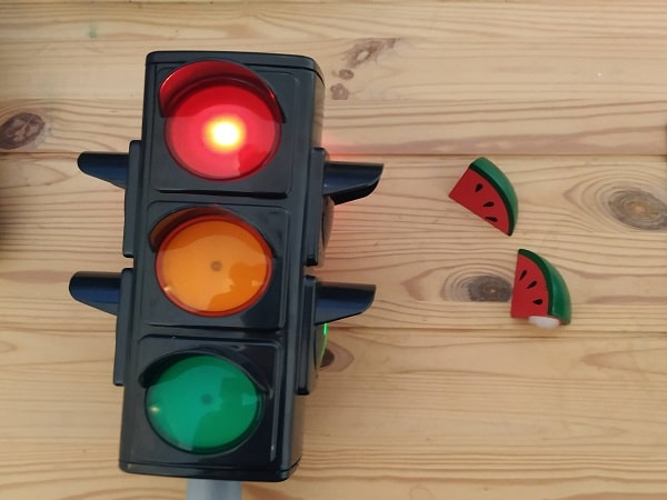 A traffic light, and a watermelon